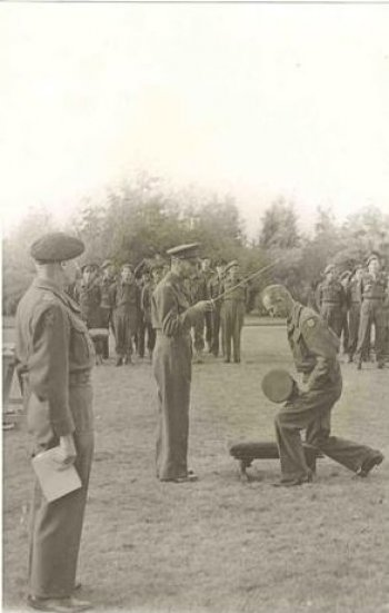 General Dempsey being knighted on the battlefield by King George VI, 15th October 1944