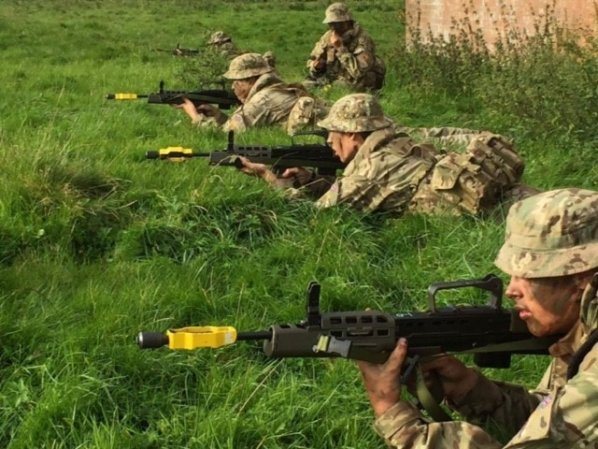 Taking up position in practice for the section in defence stand.  From rear to front: Cdt A. Bramwell, LCpl L. Lovick, Cpl Poshyanonda, LCpl G. Bramwell and Cdt O. Taylor.