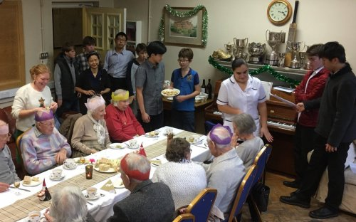 Guests, staff and Third Form hosts getting into the festive spirit at Oldham's 9th Christmas Tea Party for the elderly. 30 guests from Swan Hill, Ottley House and the Mount joined us for a full tea with carols and quiz before heading home with a small gift.