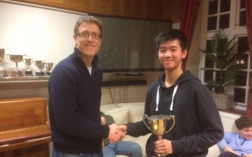 David Lau, one of the top young squash players in the country, being presented with the School's Squash Trophy by Mr Harding, April 2017
