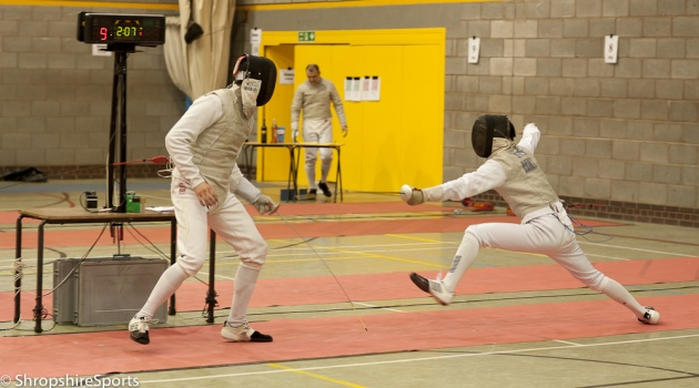 Marco Lee lunging at his opponent in the final of the Men's Foil, Shropshire Open 2013
